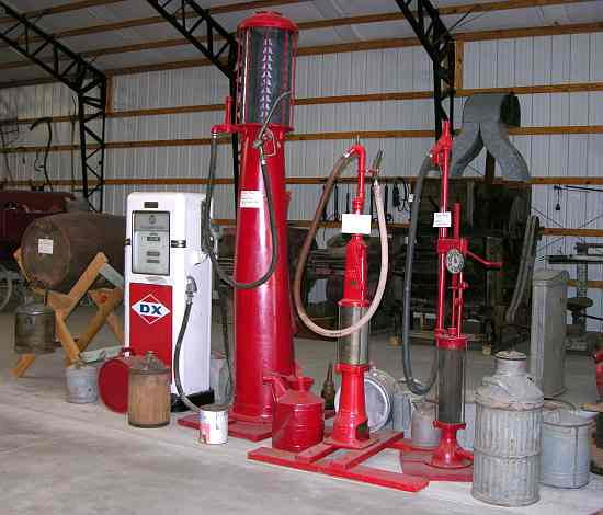 Antique  gasoline pumps and fuel cans at Ag Heritage Park