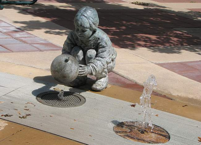 Georgia Gerber bronze sculpture and fountain along Douglas Avenue in Wichita