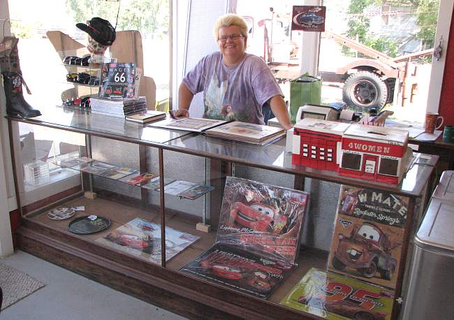 Melba Rigg with scrap book and Radiator Springs memorabilia