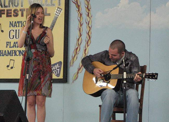 Beth Miner and Carl Miner on stage in Winfield, Kansas