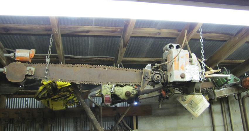 Disston chain saw with Mercury gasoline engine
