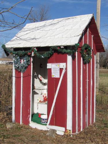 Christmas themed outhouse