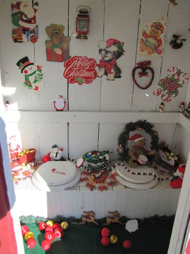 outhouse decorated for Christmas