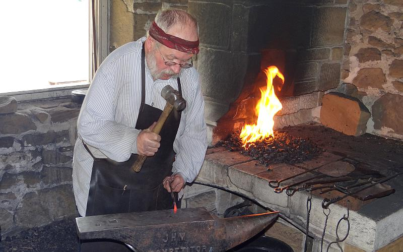 Fort Larned blacksmith at work