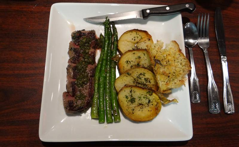 sirloin steak served with roasted potatoes and asparagus